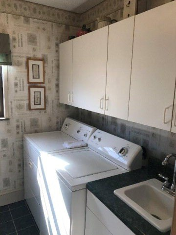 Laundry room with wash sink