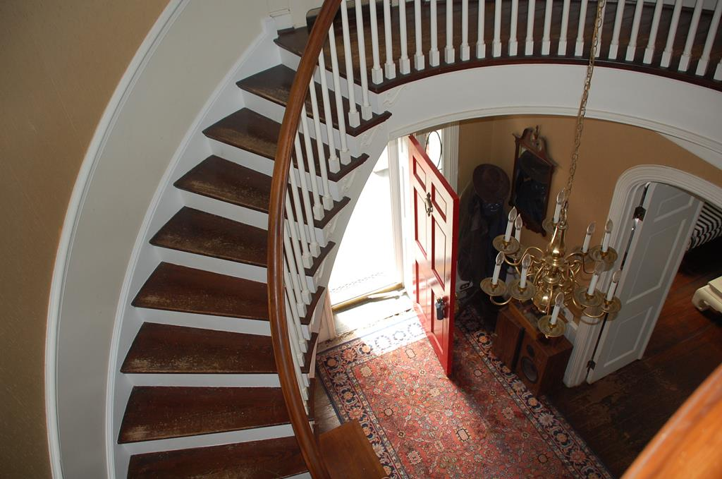 Spiral Staircase from Foyer to Upper Level