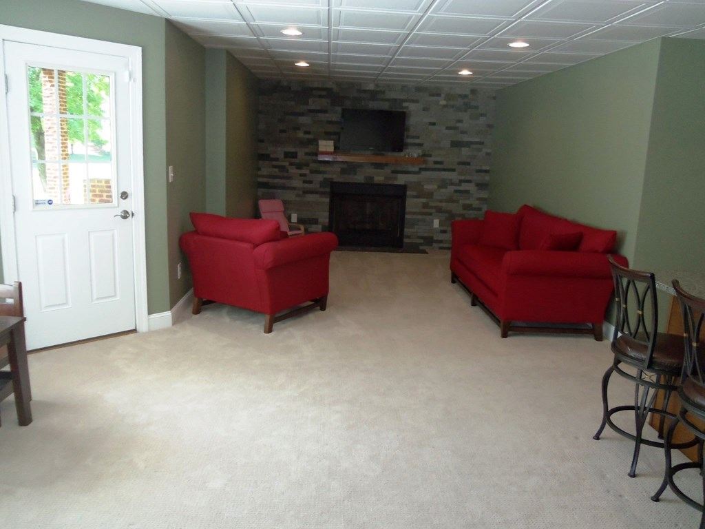Basement recreation room with gas fireplace